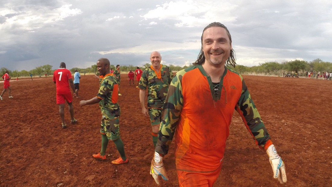 Goalkeeper Pfannenstiel gets ready to play against a local side -- which included teachers, park rangers and a veterinary surgeon -- along with fellow Global United founding member Geert Brusselers (center) and former Namibia star Lolo Goraseb.