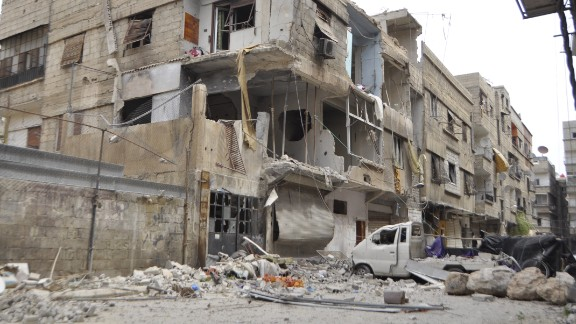 The Syrian Observatory for Human Rights says the Assad regime has dropped barrel bombs on the camp to try to drive out ISIS militants in recent days.