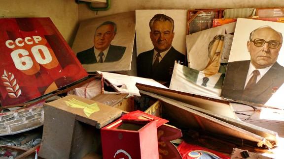 Soviet-era portraits, posters and a ballot box inside the abandoned Soviet city of Pripyat.