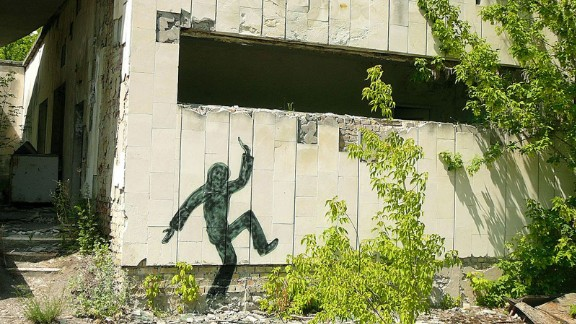 Silhouettes of dancing figures are daubed on walls of Pripyat's buildings, perhaps an attempt to bring a suggestion of human life back.