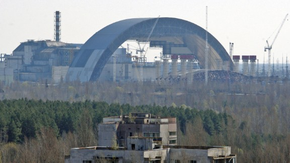 """A new """"safe containment"""" barrier is being built over the Chernobyl power plant to reinforce a sarcophagus structure originally constructed to limit the escape of radiation."""