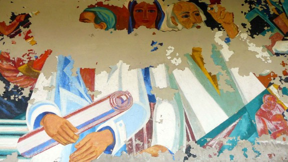 Traces of the USSR are everywhere. Vivid Soviet murals dance on walls. Faded gas masks in children's sizes lie in their dozens.