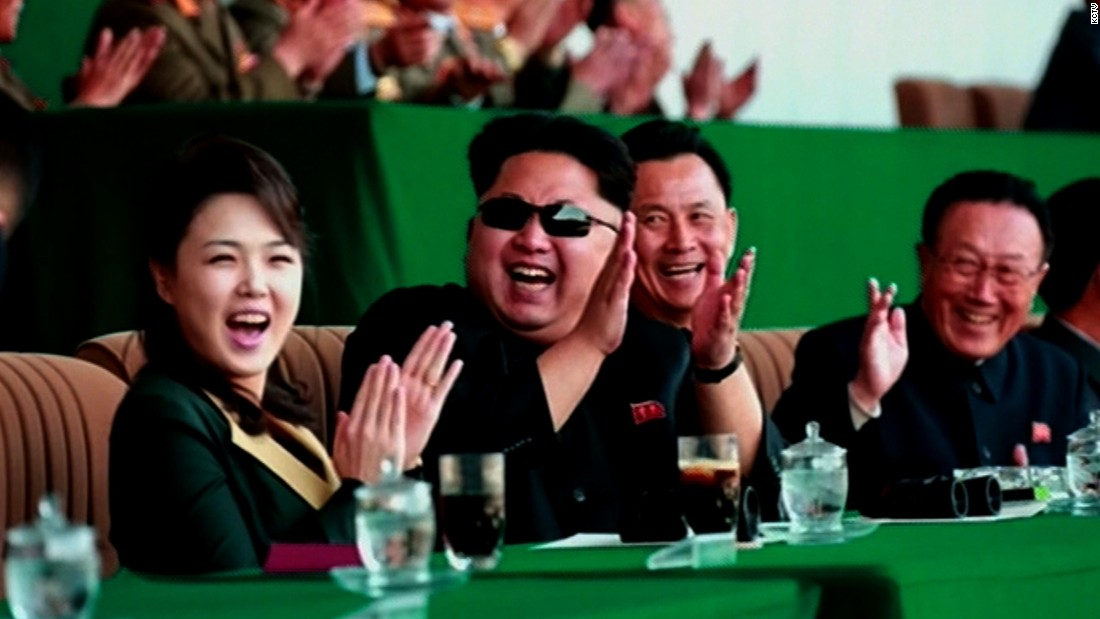 A jovial Kim Jong Un is seen clapping at a soccer match, alongside his wife Ri Sol Ju. It's the first time North Korea's first lady has been seen in public since December, 2014. It's unclear what they were cheering; it may have been the game, or a display of model gliders provided by the Pyongyang Air Club during half-time.