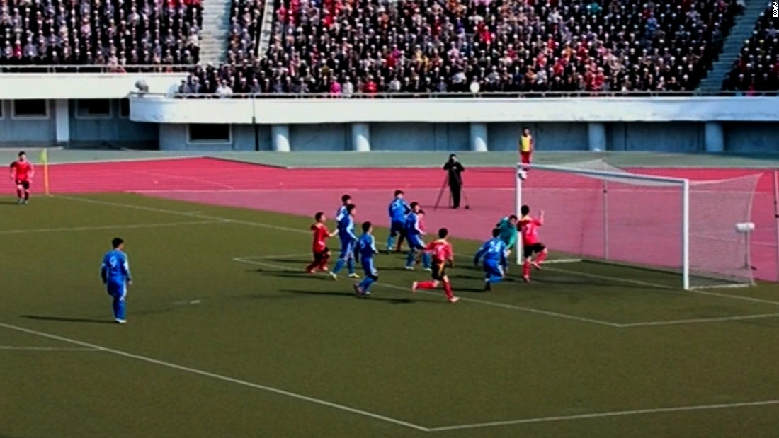 "The match pitted Sonbong Team against Hwoebul Team, with Sonbong winning 3-1. According to KCNA, ""players of both teams gave fullest play to their spiritual, physical and technical abilities, showing spectacular scenes."" Spectators can be seen packing the stands."