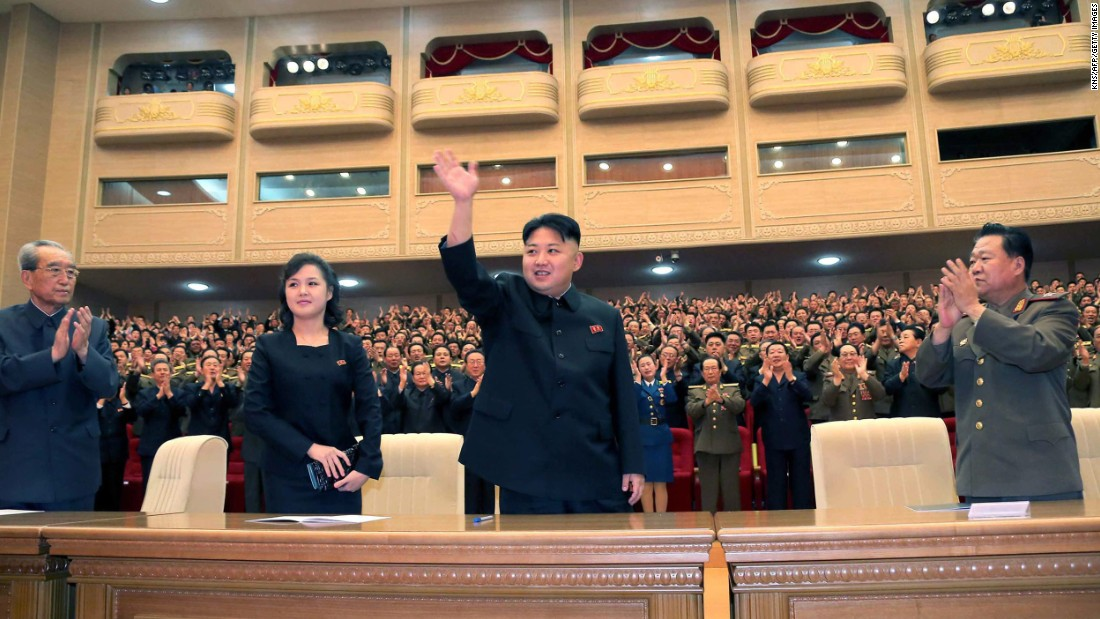 Ri was also seen by her husband's side in an image released in May, 2013, at a performance by the Song and Dance Ensemble of the Korean People's Internal Security Forces in Pyongyang.