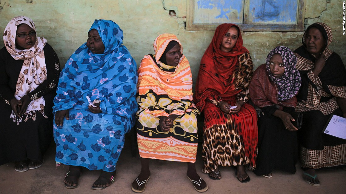 APRIL 14 - IZBA, SUDAN: Women wait for their turn to vote outside a polling station in an impoverished neighborhood on the outskirts of Khartoum, the capital city. This is the first day of the country's presidential and legislative elections, which could see current President Omar al-Bashir hold onto his leadership for another five years.
