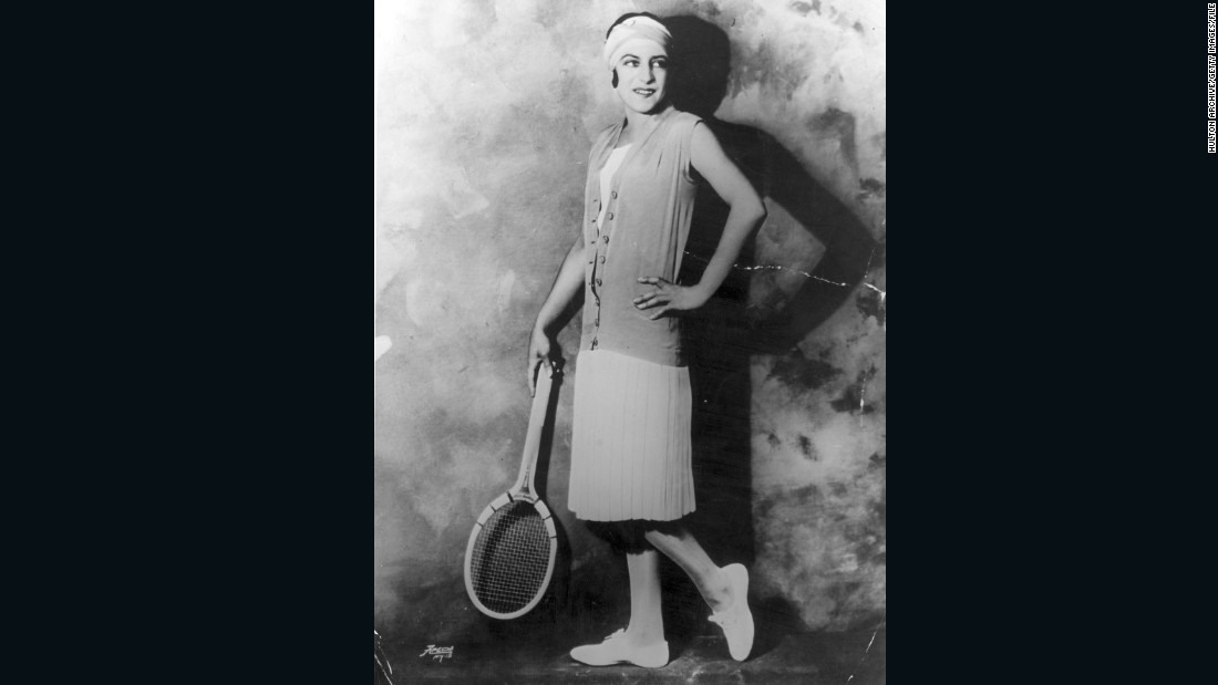 "One of the most controversial players of the 1920s was chic French star Suzanne Lenglen (pictured in 1925).<br />""She was scandalous in many different ways; sometimes sipping brandy in the changeovers,"" says Rothenberg.<br />""Suzanne really was a tennis icon who had a lot of influence on general fashion. Even the head wraps she'd wear to keep the hair out of her eyes became a fixture of 1920s fashion for women around Europe and the U.S."""