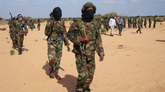 Somali Al-Shebab fighters gather on February 13, 2012 in Elasha Biyaha, in the Afgoei Corridor, after a demonstration to support the merger of Al-shebab and the Al-Qaeda network. Shebab insurgents staged rallies across Somalia on February 13 to celebrate their group