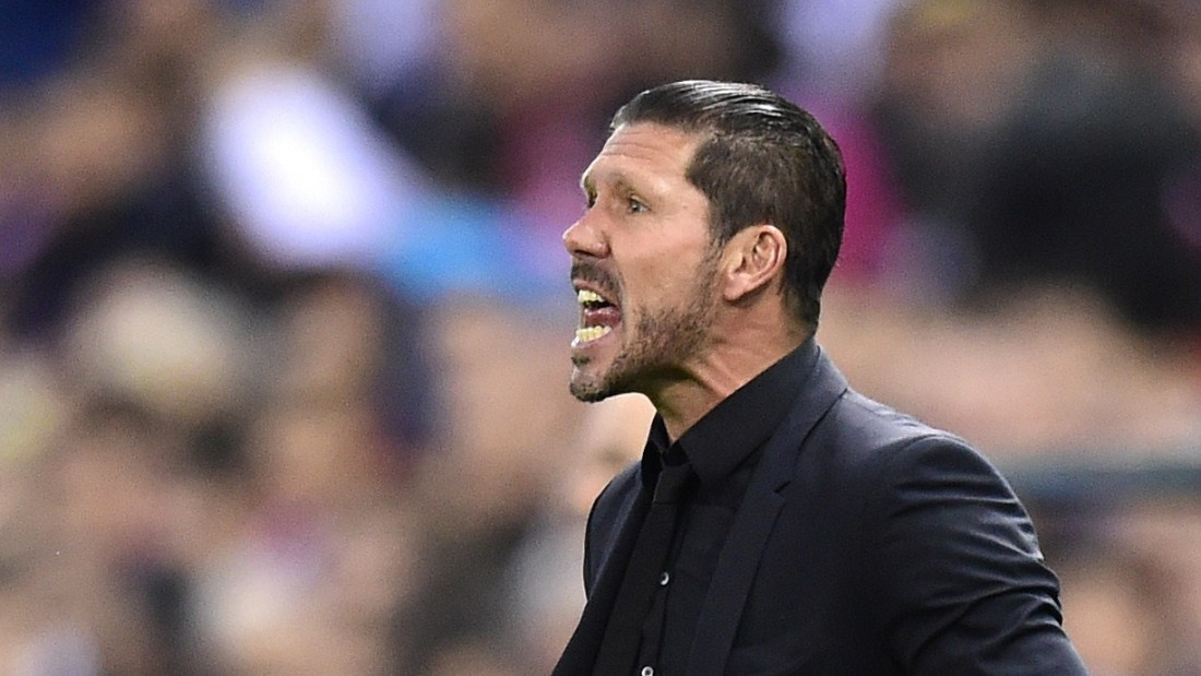 Atletico coach Diego Simeone desperately urges his team forward in the Champions League home tie against Real Madrid.