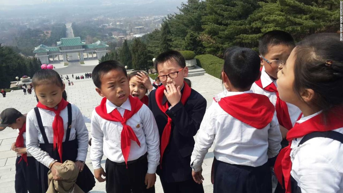 North Korean children pay their respects to Kim Il Sung at the Revolutionary Martyrs Cemetery.