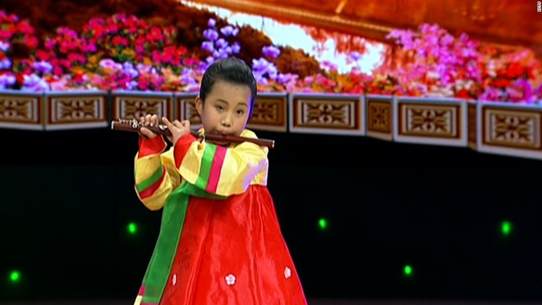 A young girl plays the flute in images on KCTV, North Korea's state television, to mark 103 years since the birth of the nation's founder Kim Il Sung.