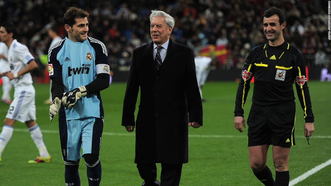 "Peruvian Nobel Prize laureate Mario Vargas Llosa (C), who most recently wrote ""The Discreet Hero"" is another avid football fan. He's pictured walking with Iker Casillas (L) of Real Madrid prior to the start of a 2010 La Liga match in Madrid, Spain."