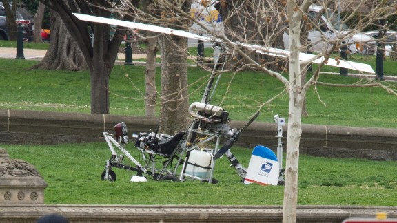 A gyrocopter sits on the West Lawn of the U.S. Capitol with members of the U.S. Capitol Police nearby April 15, 2015 in Washington, DC. Doug Hughes, 61, from Ruskin, FL., landed the gyrocopter on the West Lawn and was arrested immediately.