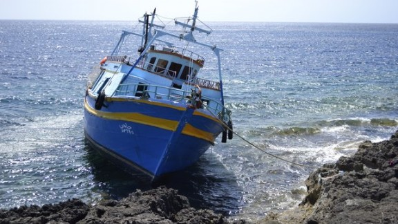 A boat on the rocks off the Italian island of Lampedusa.