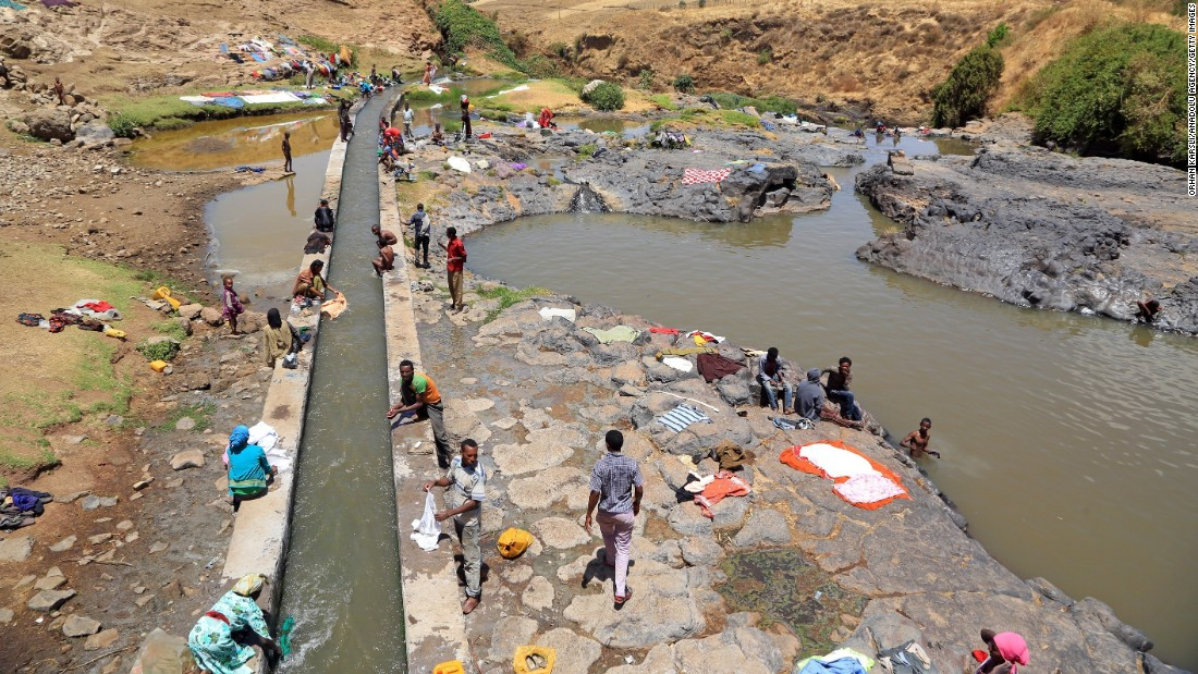 Residents wash their belongings near Qatar Fete Waterfall in Ethiopia in March.