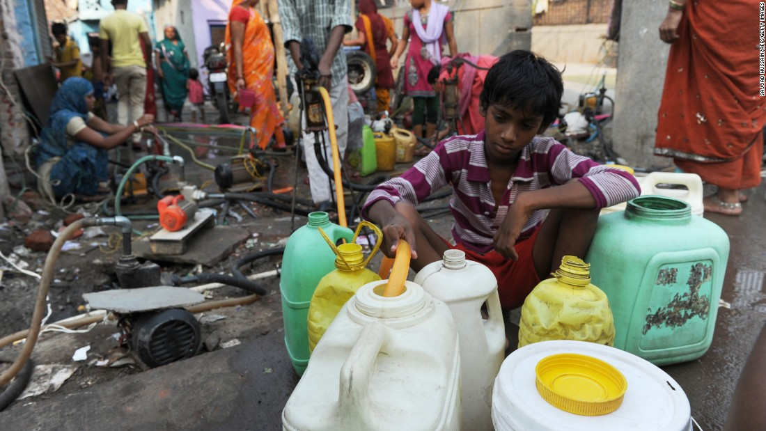 A resident fills up water containers using a hand pump in New Delhi in June 2013. With summer temperatures hovering around 45 degrees Celsius (113 F), residents struggled as the city went through a severe water shortage.