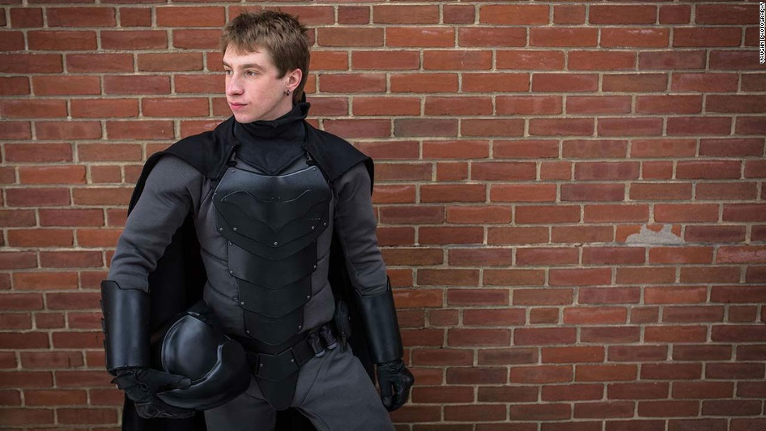 Gordon posing in the finished Batsuit, without cowl.