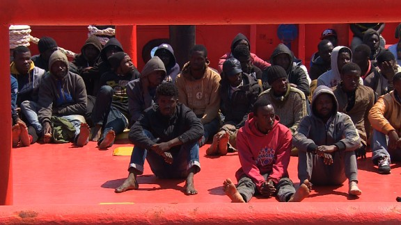 They were huddled in the back of a tugboat. Some were without shoes. Their coats and jackets, still wet, were in piled up in a huge container behind them. The 117 migrants, mostly from sub-Saharan African, arrived in the port of Augusta, Sicily, around one p.m. Tuesday, after being picked up by the tugboat off the coast of Libya. (April 14, 2015)