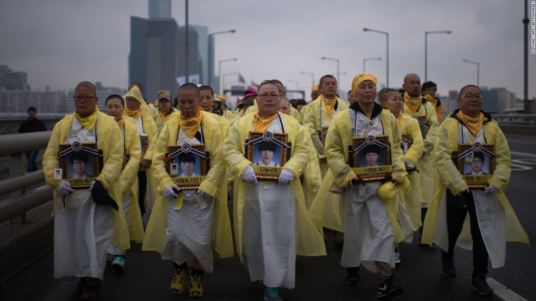 Relatives of victims of the Sewol ferry disaster march across a bridge over the Han river in Seoul on April 5, 2015. More than 200 people participated in the march from Ansan city. Many of them were the parents of the 250 students who died when the overloaded ferry sank off Jindo on April 16, 2014.