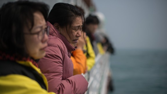 A relative of a victim weeps as she and others stand on the deck of a boat during a visit to the site of the sunken Sewol ferry on April 15, 2015 -- one day before the one year anniversary of the disaster.
