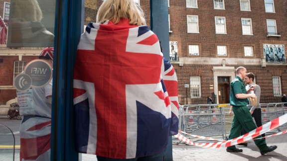 Royal supporters stand outside the Lindo Wing of St Mary