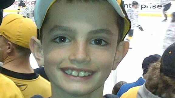 "Martin Richard, 8, was in the second grade and loved the Red Sox. He was the middle of three children and is best known for a school project in which he made a poster with a peace sign and the words ""No more hurting people."" He was less than 4 feet from the second bomb. He bled to death as his mother leaned over him, begging him to live."