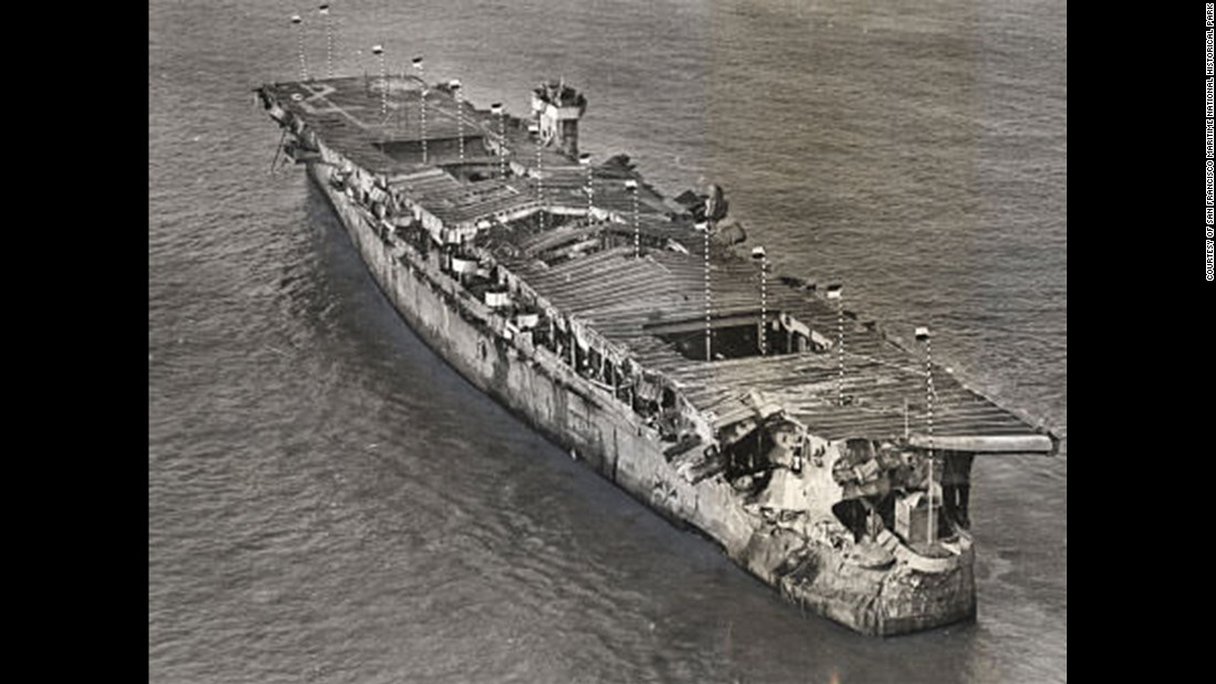 An aerial view of ex-USS Independence at anchor in San Francisco Bay, California, January 1951. There is visible damage from the atomic bomb tests at Bikini Atoll.