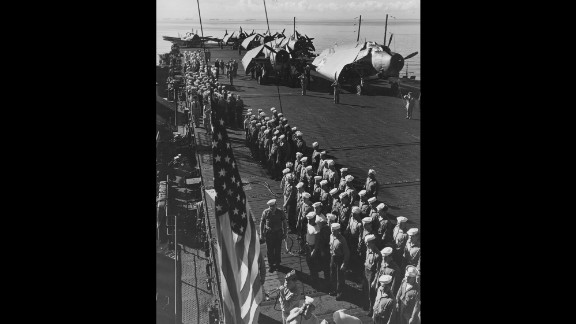 Muster on the flight deck of USS Independence in 1943. The carrier earned eight battle stars during World War II.