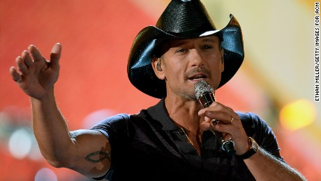 Tim McGraw performs during ACM Presents: An All-Star Salute To The Troops at the MGM Grand Garden Arena on April 7, 2014 in Las Vegas, Nevada.