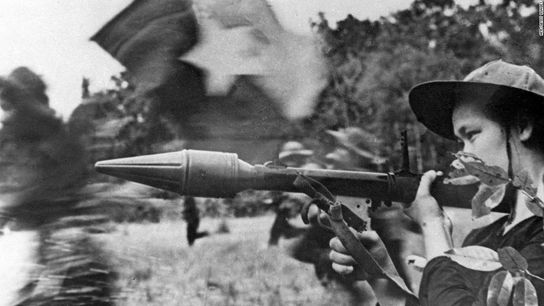 A Viet Cong soldier holds an anti-tank gun during the Tet Offensive, a massive surprise attack launched in 1968 by the North Vietnamese. The attack hit 36 major cities and towns in South Vietnam. Both sides suffered heavy casualties.