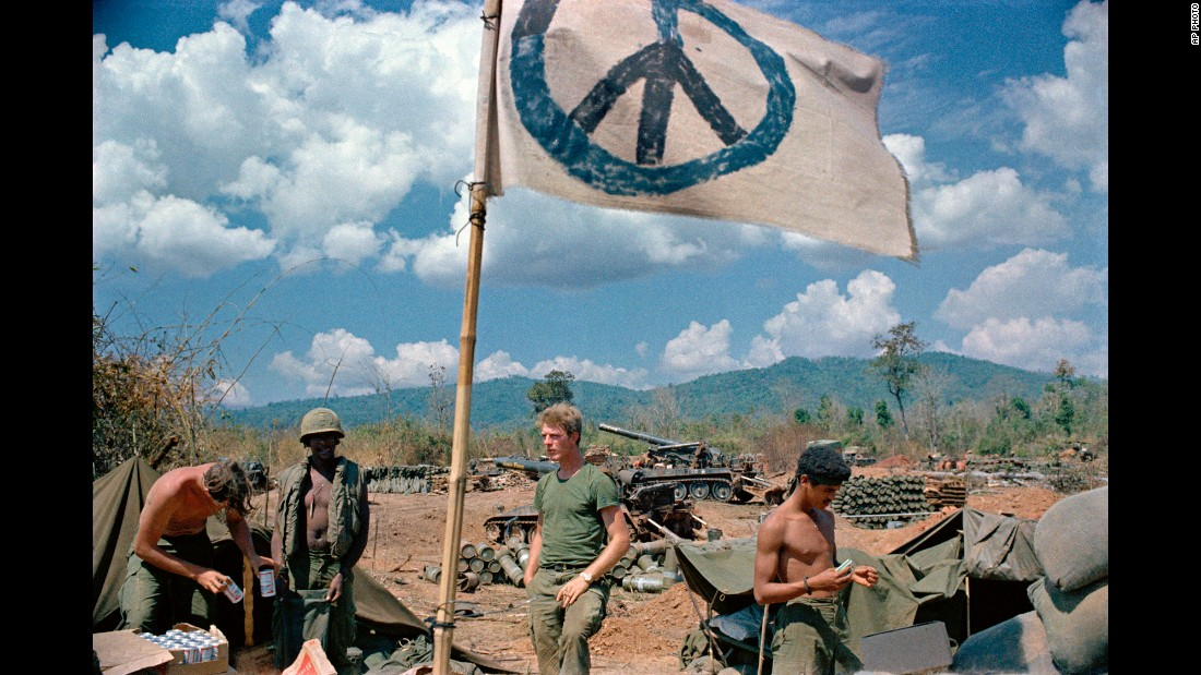 U.S. artillerymen relax under a crudely made peace flag at the Laotian border in 1971. In February 1971, U.S. and South Vietnamese troops invaded southern Laos in an effort to stop North Vietnamese supply routes. This action, ordered by President Nixon, was done without consent of Congress, and it led to more anti-war protests.