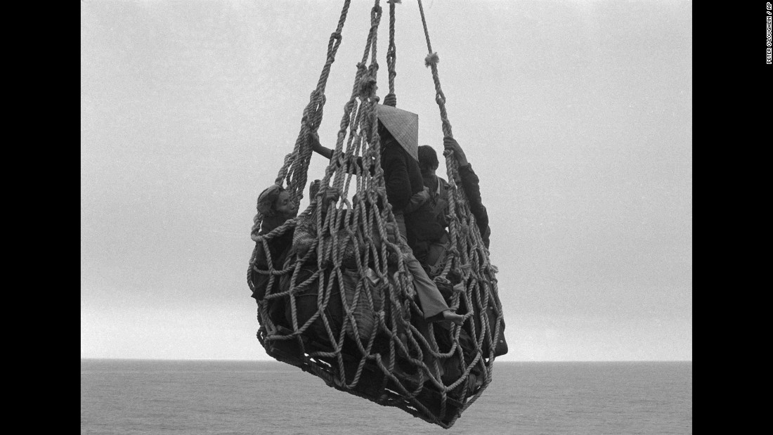A cargo net lifts refugees from a barge so they can be evacuated from the city of Da Nang, Vietnam, on April 1, 1975.