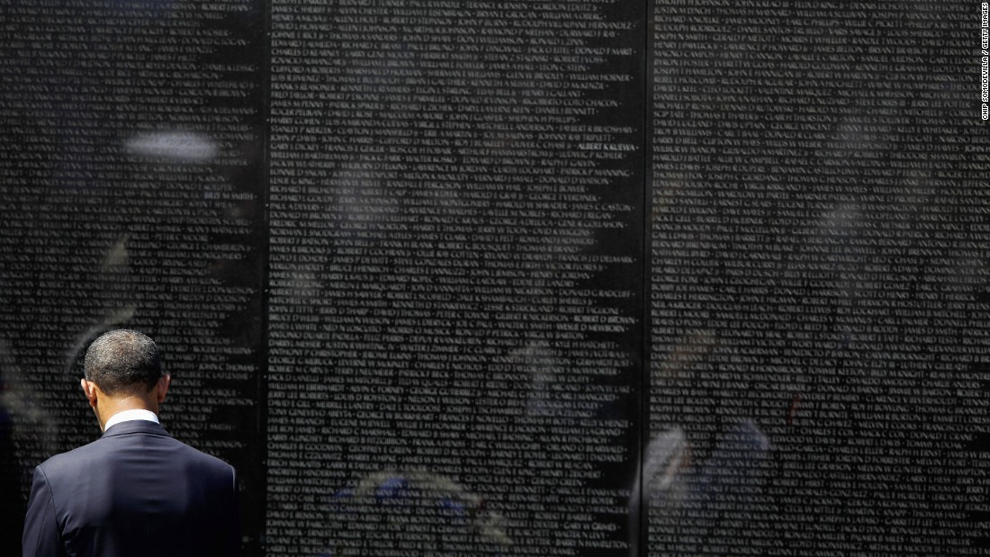 U.S. President Barack Obama stands at the Vietnam Veterans Memorial in Washington in May 2012. The black granite memorial bears the names of more than 58,000 Americans killed in the Vietnam War.