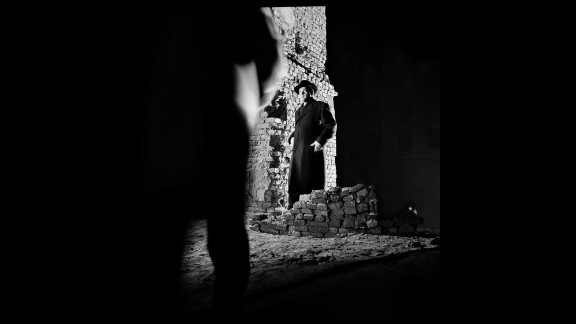 """In this photo from 1949's """"The Third Man,"""" Orson Welles is hemmed in by darkness in a way that suggests the film's shadowy themes."""
