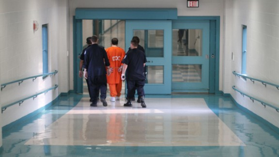 This is how Hernandez, convicted of first-degree murder, is likely to be handled by guards inside prison. Corrections officers move an inmate in leg shackles and handcuffs at Souza-Baranowski.