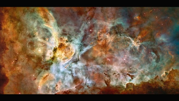 This huge nebula is 7,500 light years from Earth in the constellation Carina. It's one of the largest and brightest nebulas and is a nursery for new stars. It also has several stars estimated to be at least 50 to 100 times the mass of our Sun, including Eta Carinae, one of the brightest stars known and one of the most massive stars in the Milky Way Galaxy.