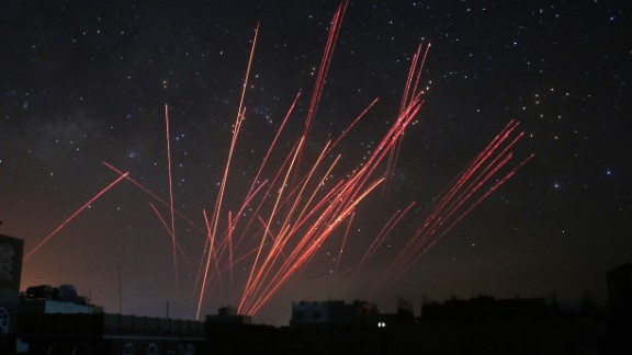 The sky over Sanaa, Yemen, is illuminated by anti-aircraft fire during a Saudi-led airstrike on Friday, April 17. The coalition