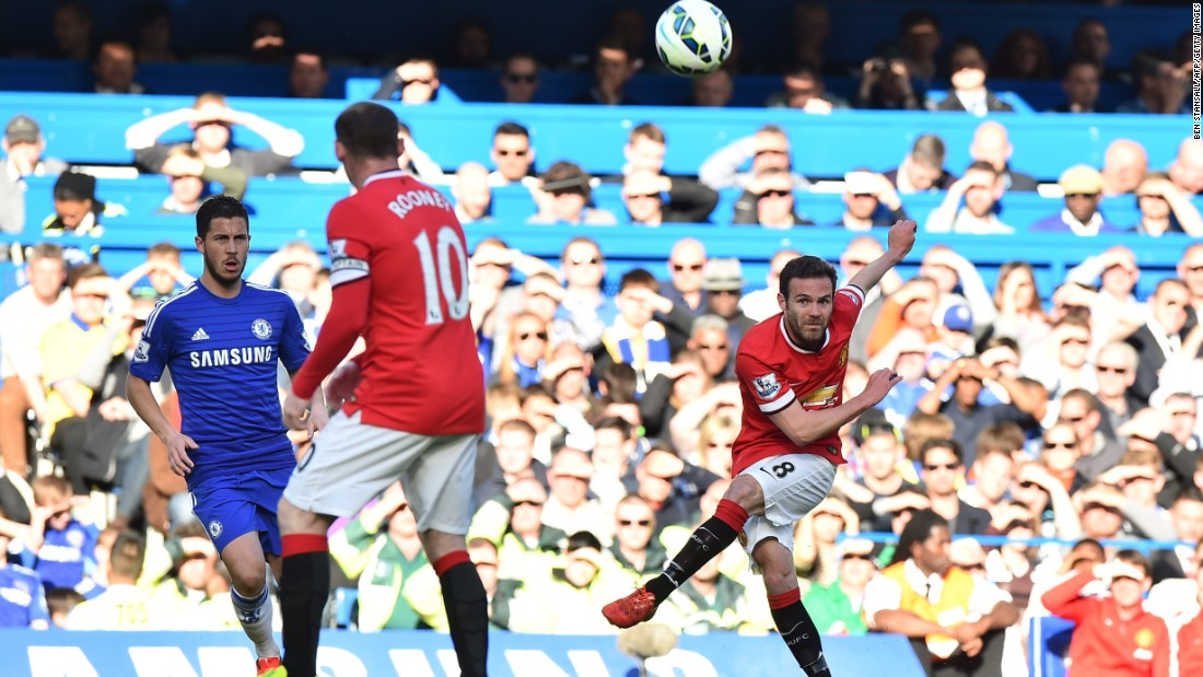 Juan Mata drives a cross into the Chelsea box as United look for a way back into the game.