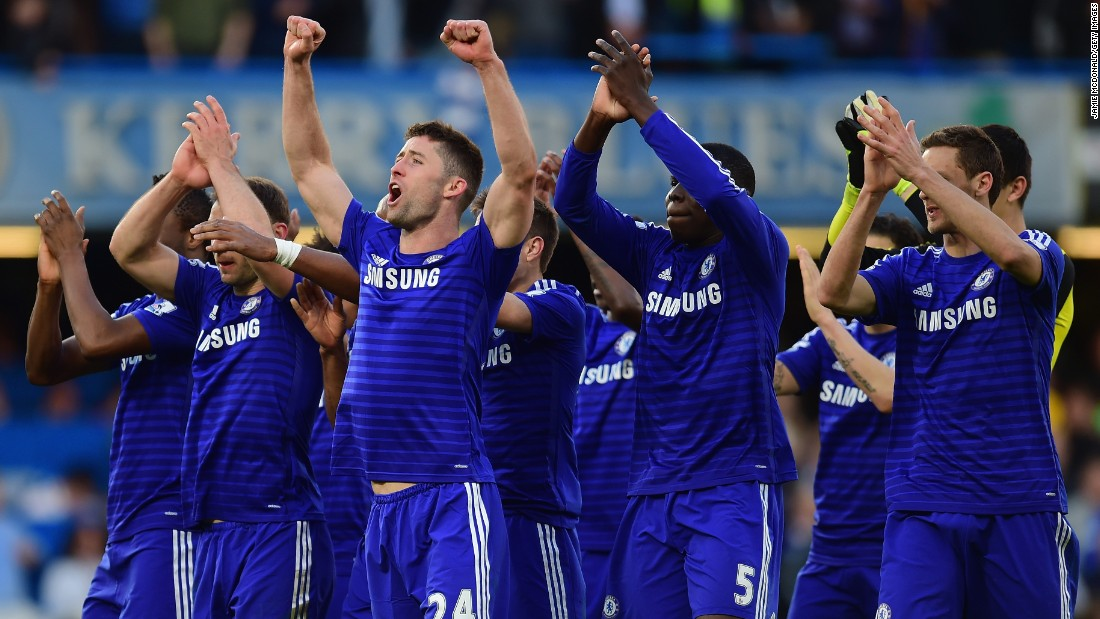 Chelsea players celebrate after the crucial 1-0 home win over Manchester Utd which left them with one hand on the EPL trophy.