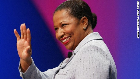 "SAN FRANCISCO - JULY 31:  Democratic presidential hopeful former Sen. Carol Moseley Braun (D-IL) waves as she arrives at a debate with Rep. Dick Gephardt (D-MO), Rep. Dennis Kucinich (D-OH), and former Vermont Gov. Howard Dean in a forum on health care issues at the United Food and Commercial Workers (UFCW) Convention July 31, 2003 in San Francisco. Bill Press, of MSNBC's ""Buchanan and Press"", moderated the debate.  (Photo by Justin Sullivan/Getty Images)"