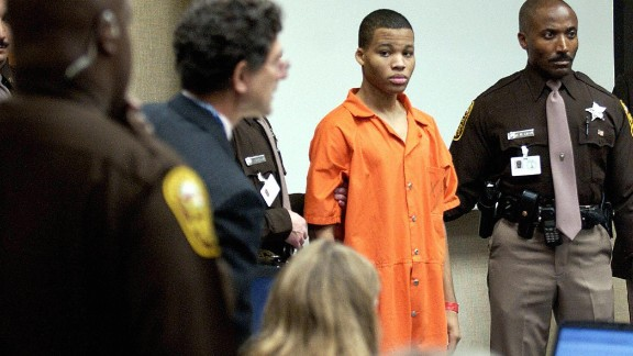 VIRGINIA BEACH, UNITED STATES:  (FILES) Sniper suspect Lee Boyd Malvo (C) is escorted by deputies as he is brought into court to be identified by a witness during the murder trial for sniper suspect John Allen Muhammad in courtroom 10 at the Virginia Beach Circuit Court 22 October, 2003, in Virginia Beach, Virginia. A Cheasapeake, Virginia jury started deliberations 17 December in the murder trial of Malvo, the teenage sniper suspect who could face the death penalty if convicted of one of10 fatal shootings that terrorized the Washington area. Malvo, who was a 17 year-old minor at the time of the crimes was tried as an adult.  AFP PHOTO/Getty Images-Davis Turner/POOL  (Photo credit should read DAVIS TURNER/AFP/Getty Images)