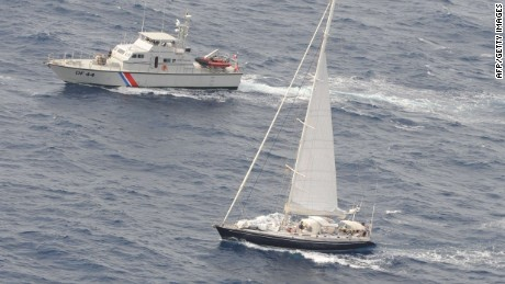 A handout photo taken on April 16, 2015 by the French customs off the French Caribbean island of Martinique, and released on April 18, shows the Silandra sailboat (C) carrying cocaine escorted to Fort-de-France by two customs vessels after the boat's interception on April 15 in the night. French finance minister Michel Sapin announced on April 18 a record seizure on the boat of 2.25 tonnes of cocaine, worth 70 millions of euros. Three Spanish nationals and a Venezuelan national were arrested on the boat. AFP PHOTO/DOUANE FRANCAISE-/AFP/Getty Images