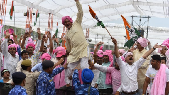 Indian Congress Party supporters shout slogans during a rally against a new land bill in Delhi on April 19, 2015.