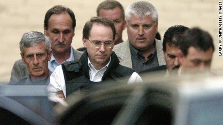 MCALESTER, OK - JUNE 11:  Convicted murderer Terry Nichols is escorted out the Pittsburg County Courthouse in handcuffs on the third day of the jury deliberations, and ending the trial with a hung jury on June 11, 2004 in McAlester, Oklahoma. Nichols was found guilty of all 161 counts of first degree murder in the bombing of the Alfred P. Murrah Federal Building April 19, 1995 in Oklahoma City, Oklahoma, Nichols faces life in prison or life in prison without parole to be handed out by Judge Taylor. (Photo by Larry W. Smith/Getty Images)