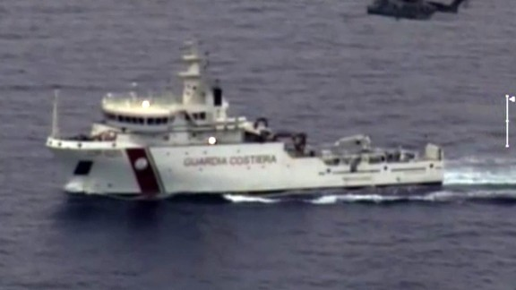 """In this video grab released by the Italian Coast Guards (Guardia Costiera) on April 19, 2015 an helicopter and a ship take part in a rescue operation off the coast of Sicily following a shipwreck last night. Rescuers at the scene of a Mediterranean shipwreck feared to have claimed 700 lives are searching for survivors amongst corpses floating in the water, Malta's Prime Minister Joseph Muscat said. Italy's coastguard said 28 people were known so far to have survived the overnight capsize of a packed fishing boat that was attempting to smuggle hundreds of migrants from Libya to Italy. The coastguard said 24 bodies had been recovered so far. AFP PHOTO / HO = RESTRICTED TO EDITORIAL USE - MANDATORY CREDIT """"AFP PHOTO / GUARDIA COSTIERA"""" - NO MARKETING NO ADVERTISING CAMPAIGNS - DISTRIBUTED AS A SERVICE T"""