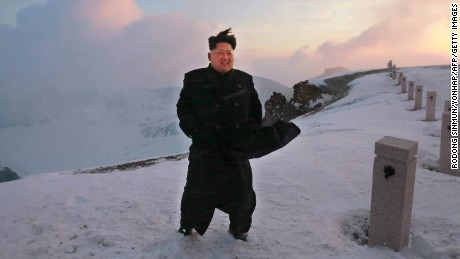 North Korean leader Kim Jong-Un stands on the snow-covered top of Mount Paektu in North Korea in a picture taken by North Korean newspaper Rodong Sinmun on April 18 and released by South Korean news agency Yonhap on April 19.  Kim  scaled the country's highest mountain, state-run media claimed, arriving at the summit to tell soldiers that the hike provides mental energy more powerful than nuclear weapons.