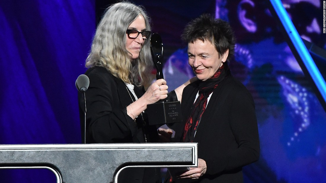 Laurie Anderson, right, accepted the award on behalf of inductee rocker Lou Reed, who died in 2013.