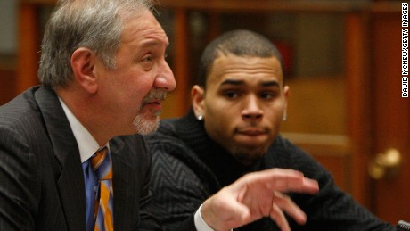 LOS ANGELES, CA - JANUARY 28:  R&B singer Chris Brown appears in court with his attorney Mark Geragos (L) for a probation progress report hearing on January 28, 2011 in Los Angeles, California. Brown pleaded guilty to assaulting his then-girlfriend, singer Rihanna, after a pre-Grammy Awards party in 2009. He was given a sentence of five years probation and ordered to complete 180 days of community labor and a year of domestic violence counseling.   (Photo by David McNew/Getty Images) *** Local Caption *** Mark Geragos;Chris Brown