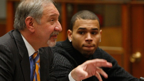 LOS ANGELES, CA - JANUARY 28:  R&B singer Chris Brown appears in court with his attorney Mark Geragos (L) for a probation progress report hearing. (Photo by David McNew/Getty Images)