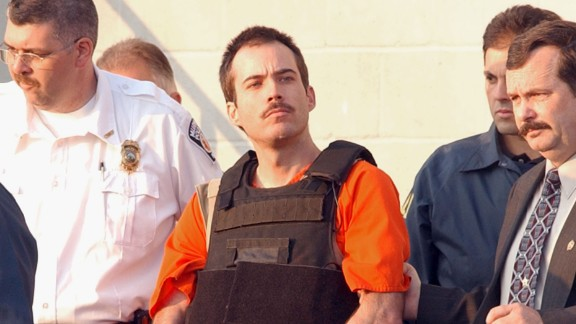Bombing suspect Eric Robert Rudolph (C) is escorted from the Cherokee County Jail for a hearing in federal court.